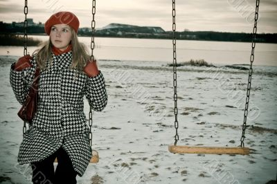 young girl alone on swing