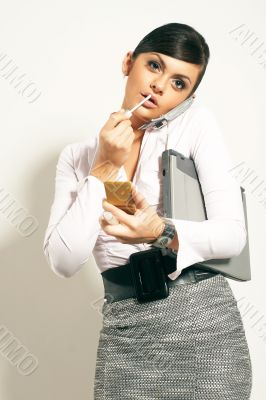 Atractive brunet businesswoman with lipstic, phone looking on cl