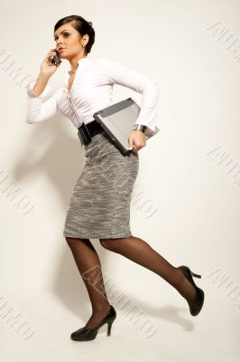 running atractive brunet businesswoman