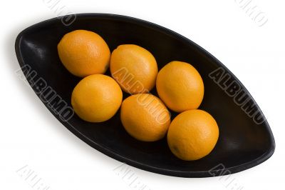Oranges into black Japanese vase 1
