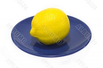 Lemon served on a blue plate