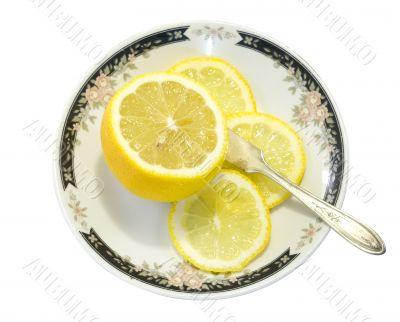 Sliced lemon served on ornamented plate 3