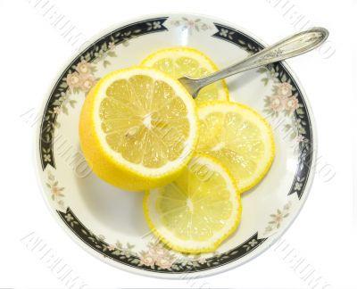 Sliced lemon served on ornamented plate 1
