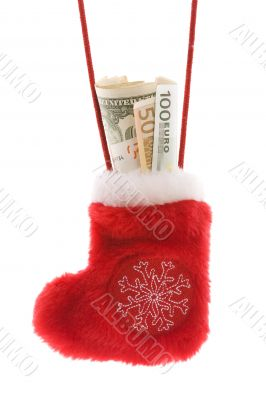 Red christmas sock with euro and dollar cash money
