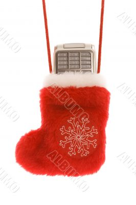 Red christmas sock with cellular phone isolated on white