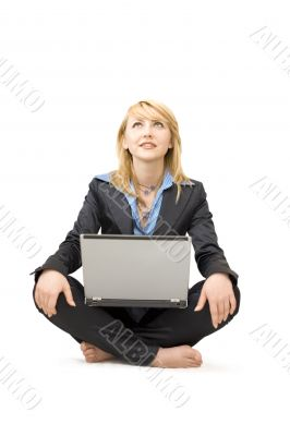 Shoeless woman with laptop do meditative exercises #2