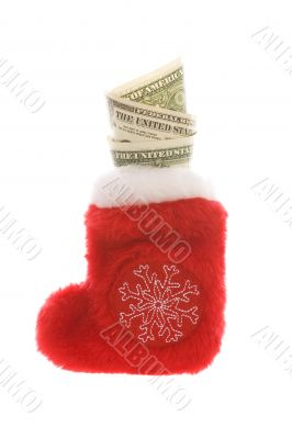 Red christmas sock with dollar cash money isolated on white