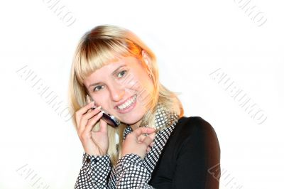 Young blond woman sms by mobile phone