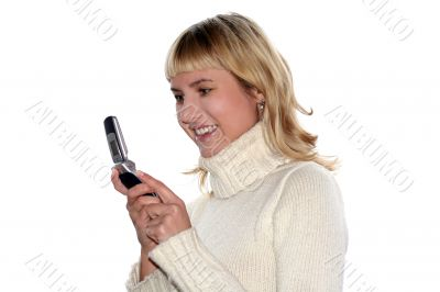 Young blond woman sms by mobile phone. She is happy