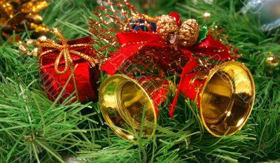 Golden bells against Xmas tree branch