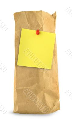 brown paper bag with yellow note