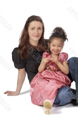 mother and daughter sit together and smile