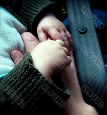 Hands of Baby in Car Seat