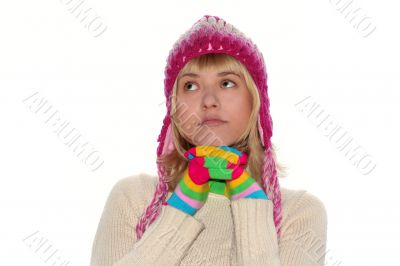 Thoughtful girl in pink cap and Multi-coloured gloves