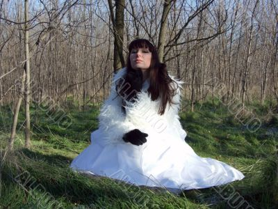 The young bride in a white dress on the nature 1