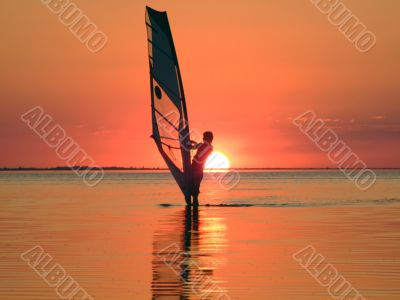 Silhouette of a windsurfer on waves of a gulf 4
