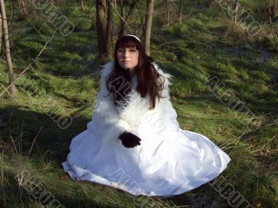The young bride in a white dress on the nature 2