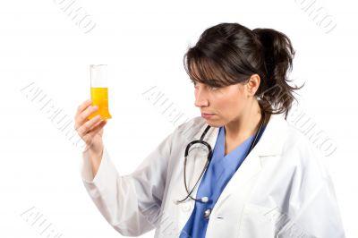 Female doctor examining test flasks