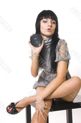 The beautiful brunette with a vinylic plate