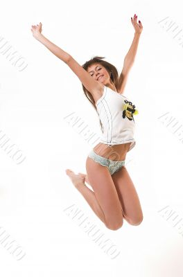 The happy girl jumps in underwear