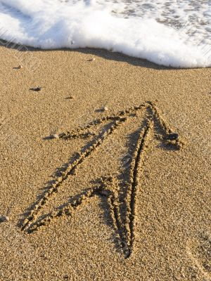 arrow on wet sea sand