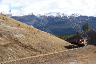 Freight train hauling up the Rocky Mountains