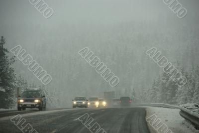 Traffic moving through fog
