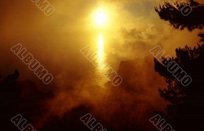 Waft of mist around the sun