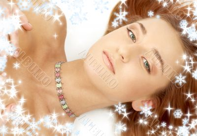 green eyed redhead in collar with snowflakes