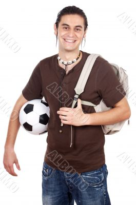 Young with soccer ball and backpack