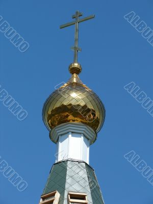 Church Cupola with Holy Cross upon blue sky