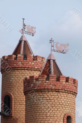 Castle Towers with Feathers Upon Blue Sky