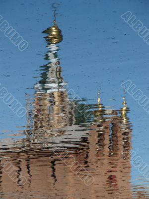Church Cupola with Cross mirrored in waves