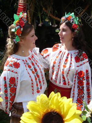 Two ukrainian girls in national folk costumes
