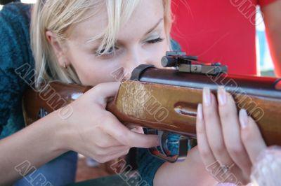 Female shooter taking aim close-up