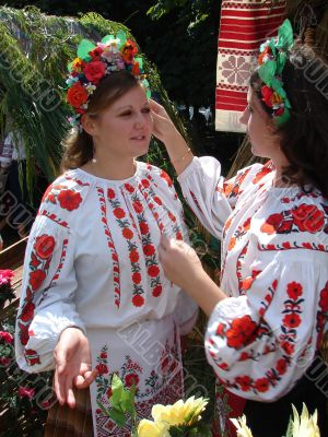 Two ukrainian girls in colorful folk costumes