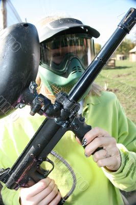 paintballer with marker gun and protective mask