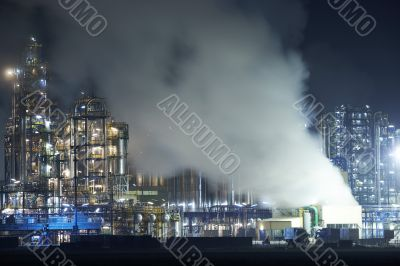 Oil refinery with cloudscape
