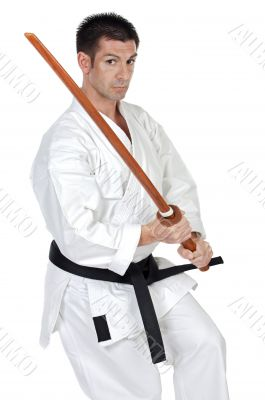 karate expert with wooden sword