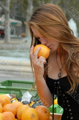 young woman smell a fruit
