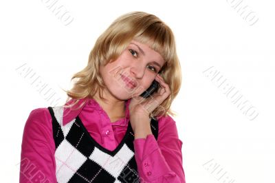 Young blond woman is calling by mobile phone
