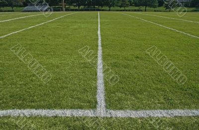 White boundary lines of football playing field