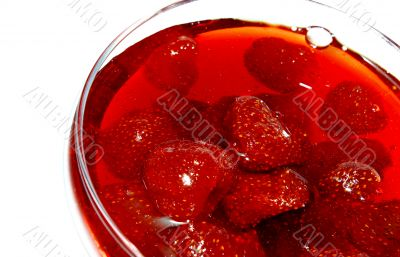 Strawberry jam in transparent glass