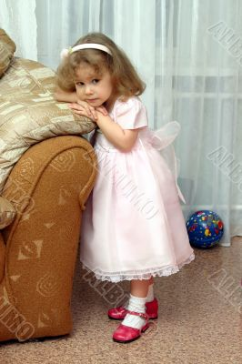 little girl in pink gown