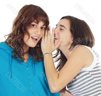 Teenager girls whispering a secret