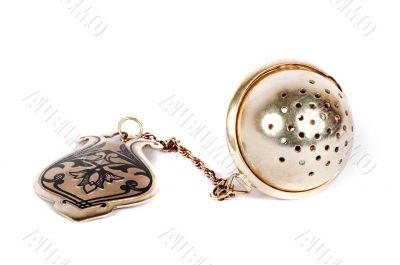silver tea-strainer