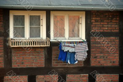 laundry hanging at the window