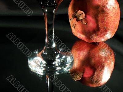 Pomegranate and wineglass