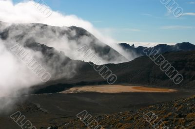 Volcano crater and cloud as fog over it