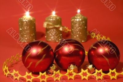 Gold candles and red glass balls